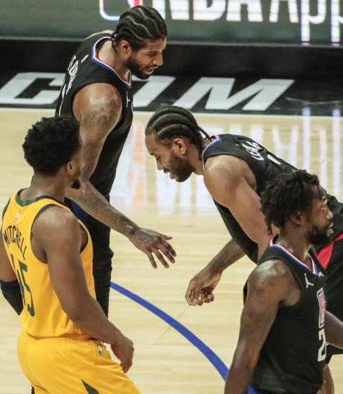 Clippers forward Kawhi Leonard is in pain as teammate Paul George checks on him during Game 4 against the Jazz.