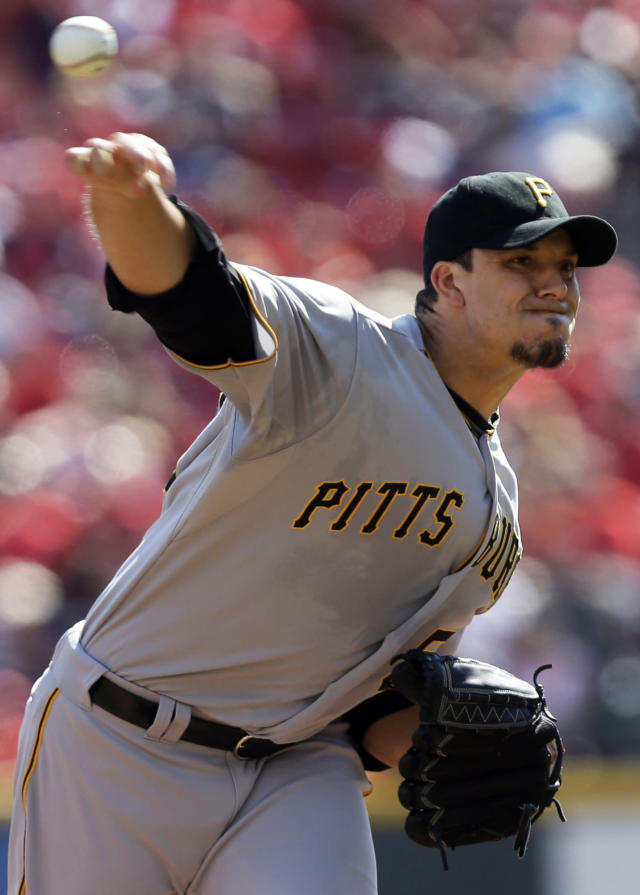 Pittsburgh Pirates starting pitcher Charlie Morton throws against the Cincinnati Reds in the first inning of a baseball game, Saturday, Sept. 28, 2013, in Cincinnati. (AP Photo/Al Behrman)