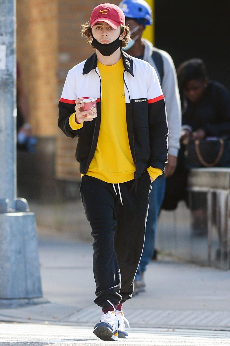 <p>Timothée Chalamet walks through N.Y.C.'s meatpacking district, enjoying a coffee and chatting on the phone on Wednesday.</p>