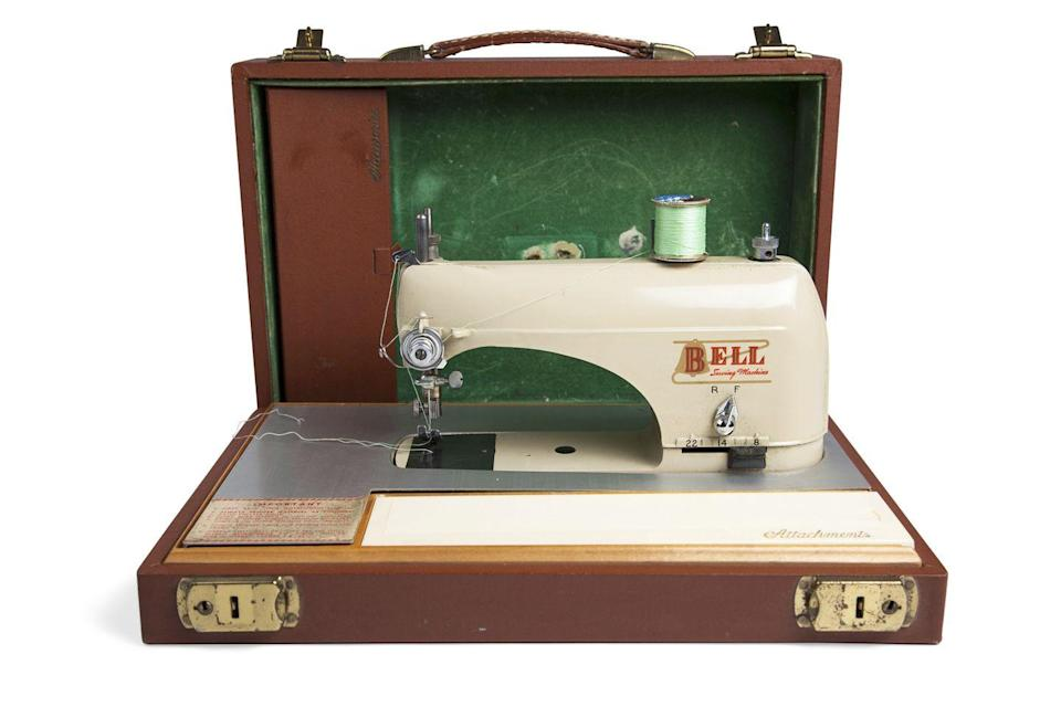 """<p>Sometimes called the """"Micro Bell,"""" your petite sewing machine is a 1950s Portable Bell Sewing Machine made by Freeland, Pennsylvania-based Bell Manufacturing Corp. Appraiser Helaine Fendelman says this small machine, which measures just 4 by 9 1/2 by 14 inches and weighs only 8 pounds when tucked into its leather attaché case, was intended for occasional home use and sewing on the go. All the necessary sewing accessories fit into tiny compartments tucked beneath the machine in its green baize-lined (a felt- like woolen material) case. """"Although this little gem's value has not increased,"""" says Helaine, """"collectors love it because, when it's in good condition like yours, it still works very well as a portable machine.""""</p><p><strong>What it's worth: </strong>$125</p>"""