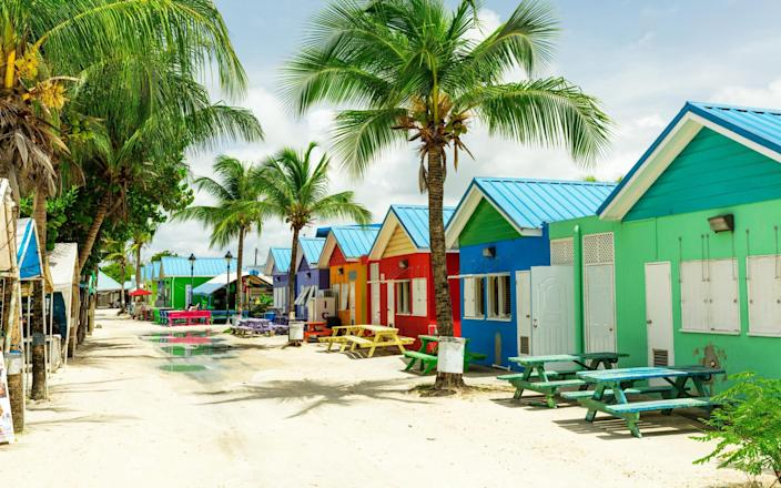 Colourful houses on the tropical island of Barbados in the Caribbean - Getty