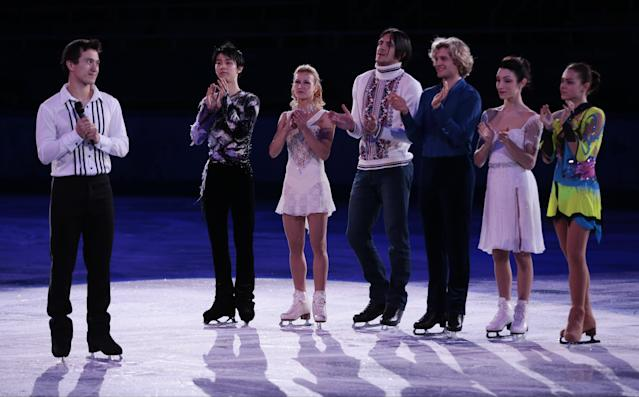 Patrick Chan of Canada, left, speaks on behalf of the skaters during the figure skating exhibition gala at the Iceberg Skating Palace during the 2014 Winter Olympics, Saturday, Feb. 22, 2014, in Sochi, Russia. In back, from right to left, Adelina Sotnikova of Russia, Meryl Davis and Charlie White of the United States, Tatiana Volosozhar and Maxim Trankov of Russia, and Yuzuru Hanyu of Japan. (AP Photo/Ivan Sekretarev)