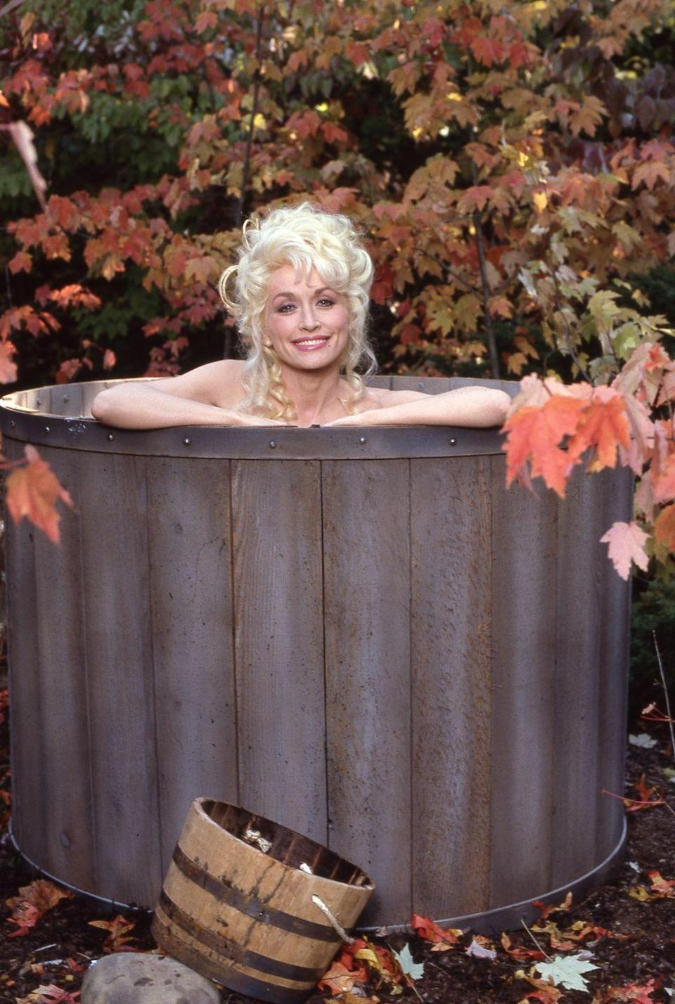 <p>Dolly smiles for this cheeky photo of her in Dollywood back in 1987</p>