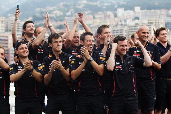 Team mates applaud race winner Mark Webber of Australia and Red Bull Racing at the swimming pool on the Red Bull Energy Station after winning the Monaco Formula One Grand Prix at the Circuit de Monaco on May 27, 2012 in Monte Carlo, Monaco. (Photo by Mark Thompson/Getty Images)