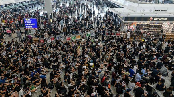 PHOTO: Hong Kong protesters block access to the departure gates during another demonstration at Hong Kong's international airport on Aug. 13, 2019. (Philip Fong/AFP/Getty Images)