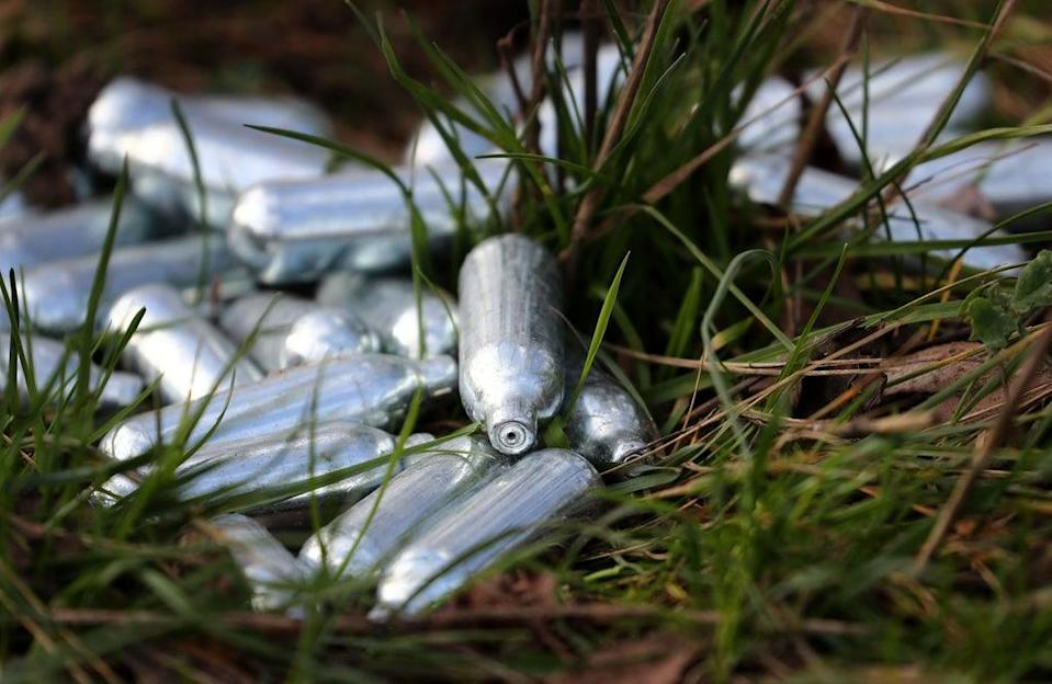 Canisters of laughing gas discarded by the side of a road near Ebbsfleet, Kent.(Gareth Fuller/PA) (PA Archive)