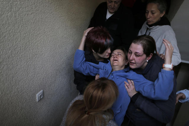 <p>Soledad Carrasquilla Delgado, 53, gets help from her daughter, sister, husband and two members of the Mortgage Victims Platform (PAH) as she faints during a panic attack following the postponement of her family's eviction in Madrid, Oct. 30, 2013. (AP Photo/Andres Kudacki) </p>
