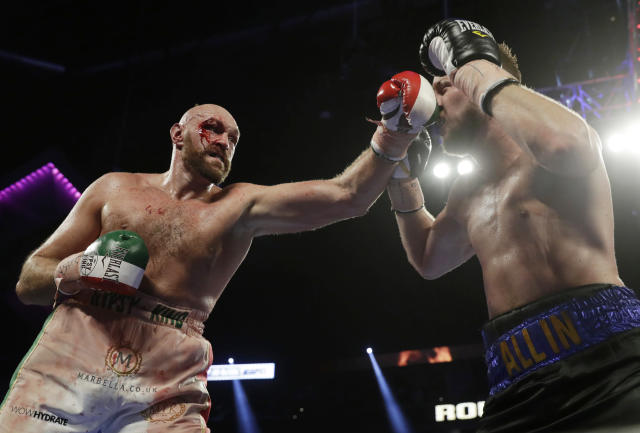 Tyson Fury, left, of England, punches Otto Wallin, of Sweden, during their heavyweight boxing match Saturday, Sept. 14, 2019, in Las Vegas. (AP Photo/Isaac Brekken)