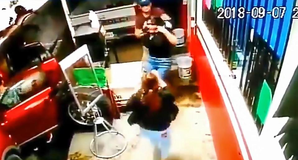 A teenage girl in Monterrey, in the north-eastern Mexican state of Nuevo Leon, is grabbed by her would-be kidnappers who try and force her into a car.