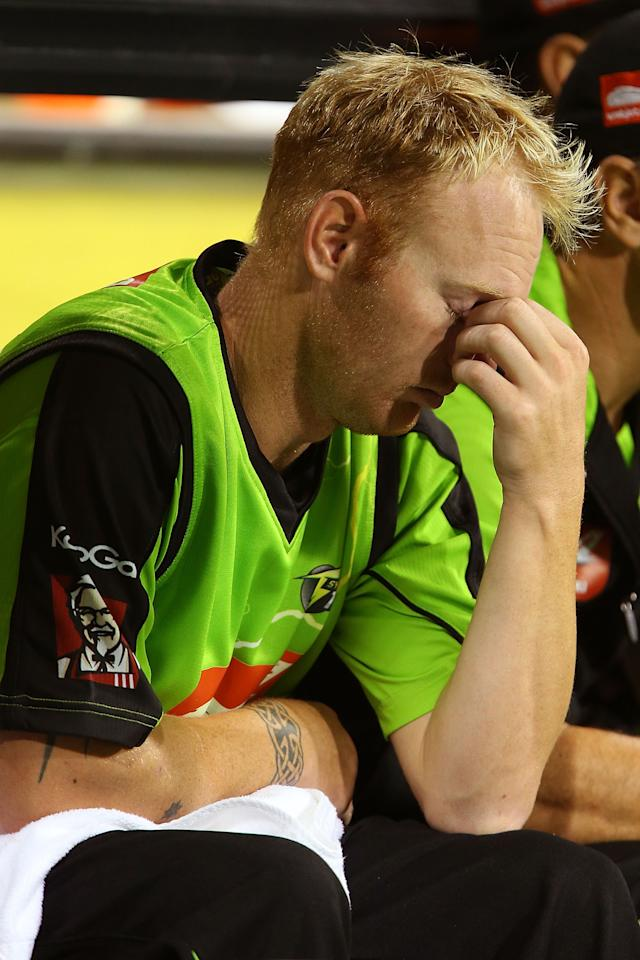PERTH, AUSTRALIA - JANUARY 04:  Scott Coyte of the Thunder sits in the dug-out after being substituted out of the game during the Big Bash League match between the Perth Scorchers and the Sydney Thunder at WACA on January 4, 2013 in Perth, Australia.  (Photo by Paul Kane/Getty Images)
