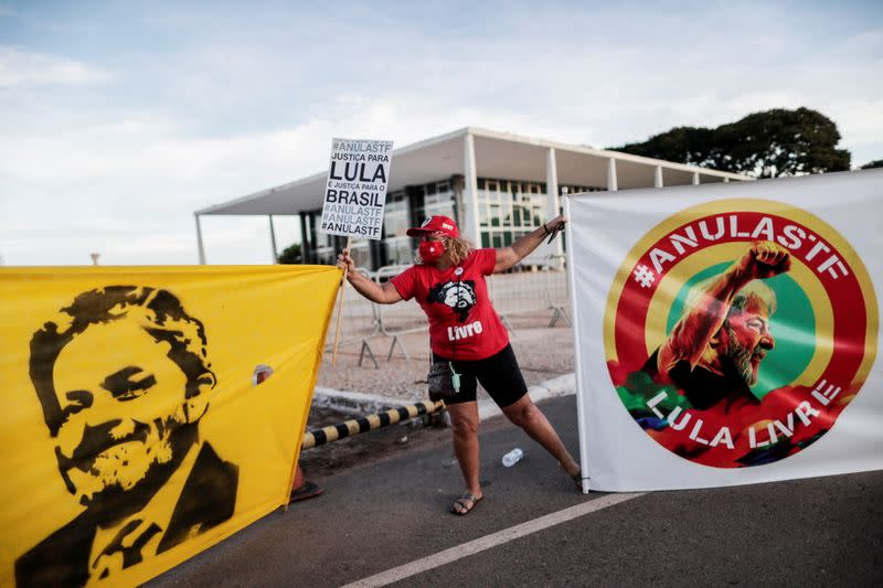FILE PHOTO: A supporter of Brazil's former President Luiz Inacio Lula da Silva takes part in a protest in front of the Supreme Court in Brasilia