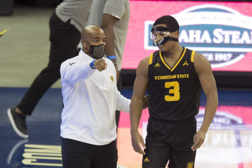 Kennesaw State coach Amir Abdur-Rahim talks with Chris Youngblood during the first half of the team's NCAA college basketball game against Creighton in Omaha, Neb., Friday, Dec. 4, 2020. (AP Photo/Kayla Wolf)