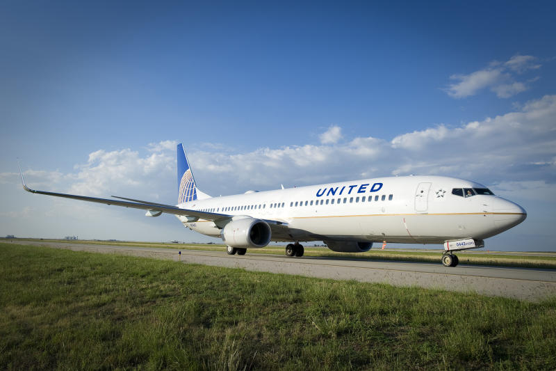 A United Continental 737 taxis towards the runway.