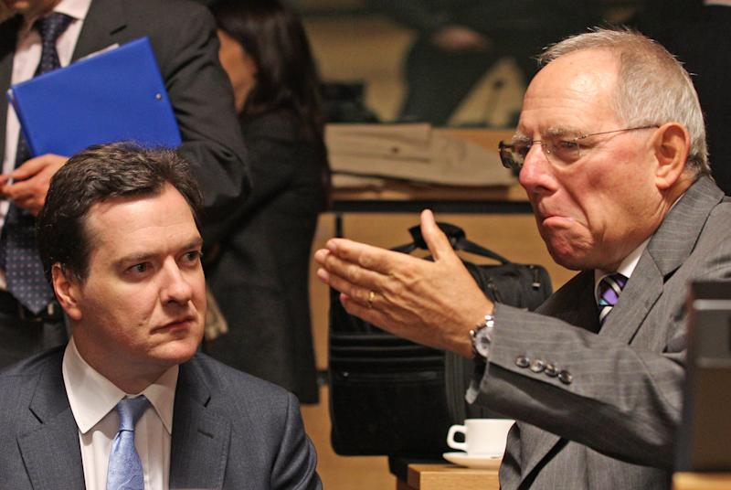 British Chancellor of the Exchequer George Osborne, left, listens to German Finance Minister Wolfgang Schaeuble, at the EU finance ministers meeting, in Luxembourg, Tuesday Oct. 9, 2012. EU finance ministers assess the budgetary situation in Portugal and address the challenges of the European financial crisis. (AP Photo/Yves Logghe)