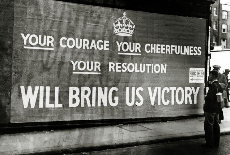 A poster on a London street in September 1939 praises courage, cheerfulness and resolution