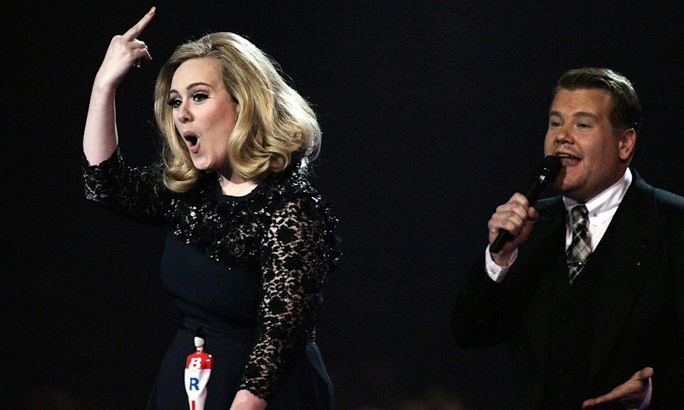 "Adele made sure her feelings were known when James Corden had to cut her off during her acceptance speech for Best British Album as she put her middle finger up in a defiant gesture to producers. Meanwhile, a mortified Corden later took to Twitter after the ceremony to <a href=""https://www.nme.com/news/music/adele-257-1280562"" rel=""nofollow noopener"" target=""_blank"" data-ylk=""slk:explain how he had been told to cut the 'Hello' singer off"" class=""link rapid-noclick-resp"">explain how he had been told to cut the '<em>Hello</em>' singer off</a> mid-flow. (PA)"