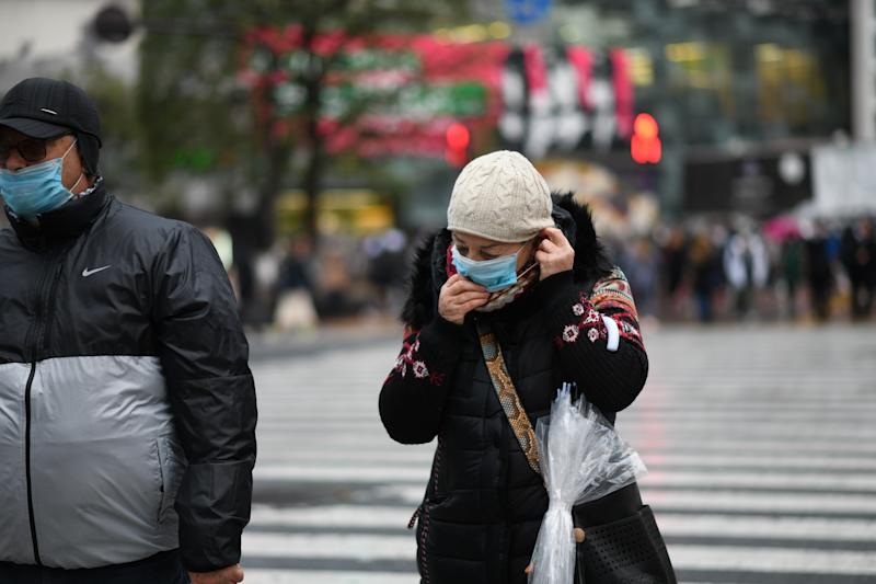 TOKYO, JAPAN - MARCH 2: Tourists wearing protective masks cross an intersection at the Shibuya district in Tokyo, Monday, March 2, 2020. Coronavirus has spread to more than 60 countries and more than 3,000 people have died from the virus known as COVID-19. (Photo: Richard Atrero de Guzman/ Sipa USA)