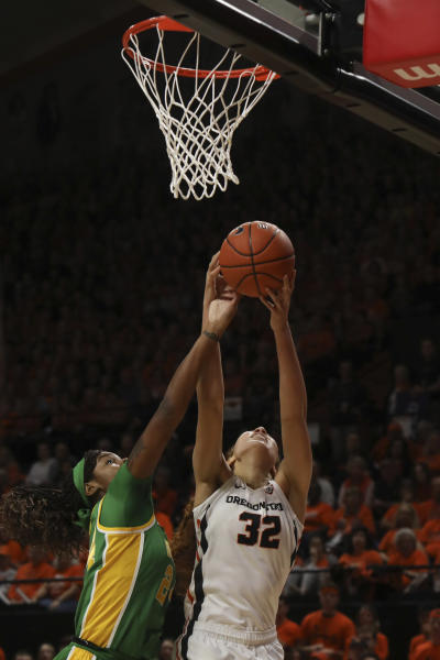Oregon State's Patricia Morris (32) and Oregon's Ruthy Hebard (24) fight for possession of a rebound during the first half of an NCAA college basketball game in Corvallis, Ore., Sunday, Jan. 26, 2020. (AP Photo/Amanda Loman)