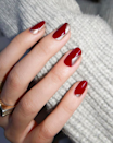 Playing with negative space is a sophisticated take on holiday nail art, even if you stick to a classic palette of burgundy and gold.