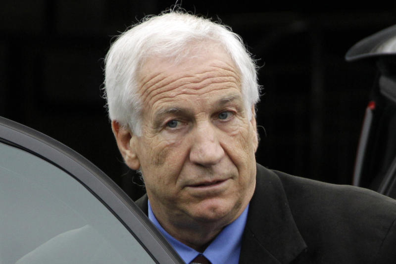 "FILE - In this June 18, 2012 file photo, former Penn State University assistant football coach Jerry Sandusky leaves the Centre County Courthouse in Bellefonte, Pa. Hall of Fame coach Joe Paterno and other senior Penn State officials ""concealed critical facts"" about Jerry Sandusky's child abuse because they were worried about bad publicity, according to an internal investigation into the scandal released Thursday July 12, 2012. (AP Photo/Gene J. Puskar, File)"