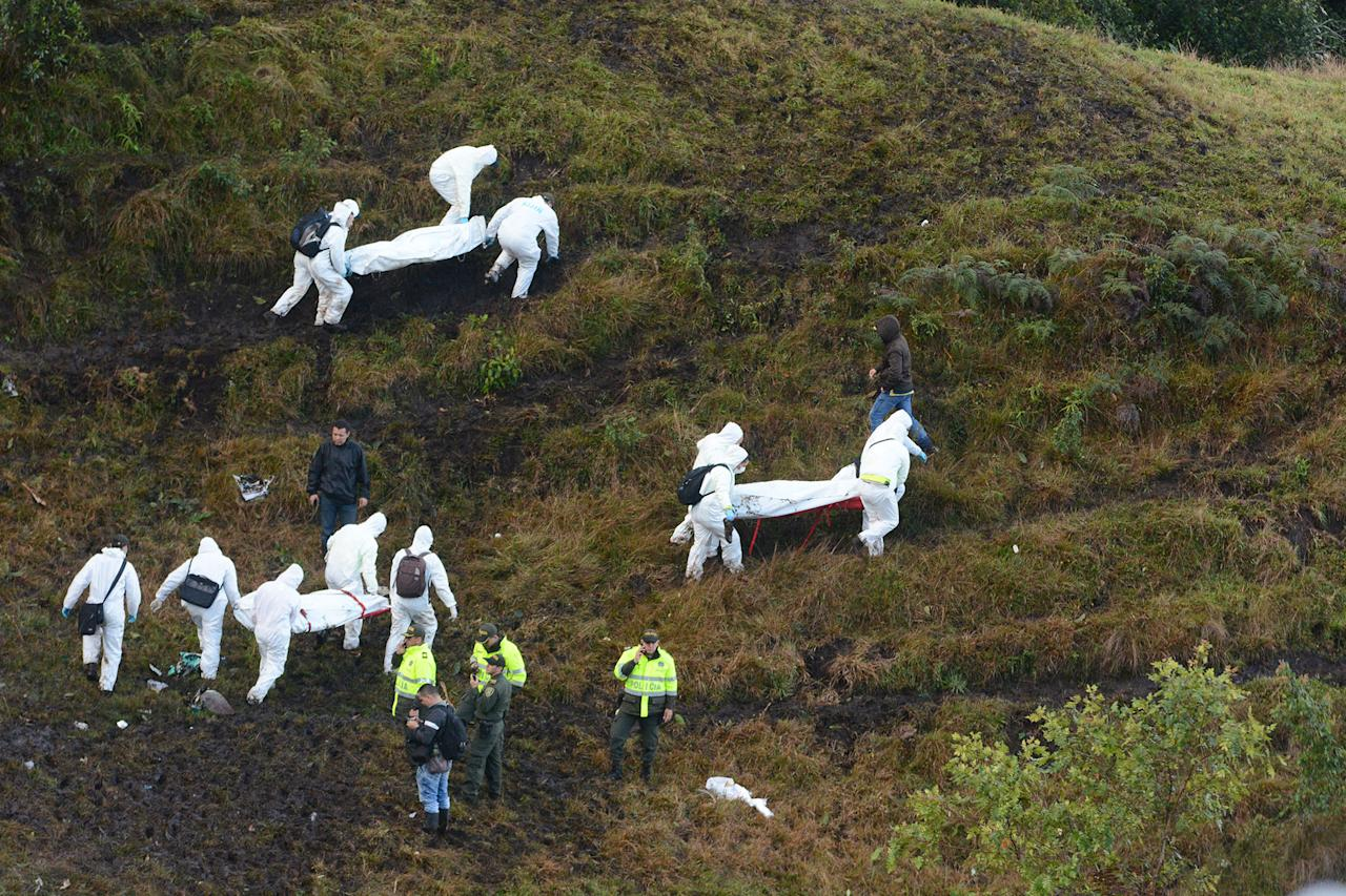 <p>Rescue workers carry the boris of victims of an airplane that crashed in La Union, a mountainous area outside Medellin, Colombia, Tuesday , Nov. 29, 2016. (AP Photo/Luis Benavides) </p>