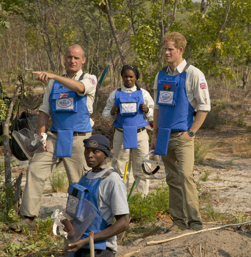 **Editorial use only, mandatory credit HALO Trust** Previously unreleased handout photo issued by HALO Trust of Prince Harry on a recent visit to Angola. (Left to right) Gerhard Zank; deminer Mateus Canhanga; section leader Maria Ilda da Piedade; Prince Harry. HALO team and Prince Harry discuss future mine clearance priorities while villagers await their land being returned safe and demined.