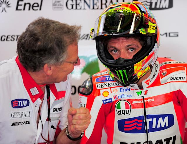 Ducati Team's Italian rider Valentino Rossi speaks with his engineers in his pits at the Catalunya racetrack in Montmelo, near Barcelona, on June 2, 2012, during the MotoGP third training session of the Catalunya Moto GP Grand Prix. AFP PHOTO / JOSEP LAGOJOSEP LAGO/AFP/GettyImages