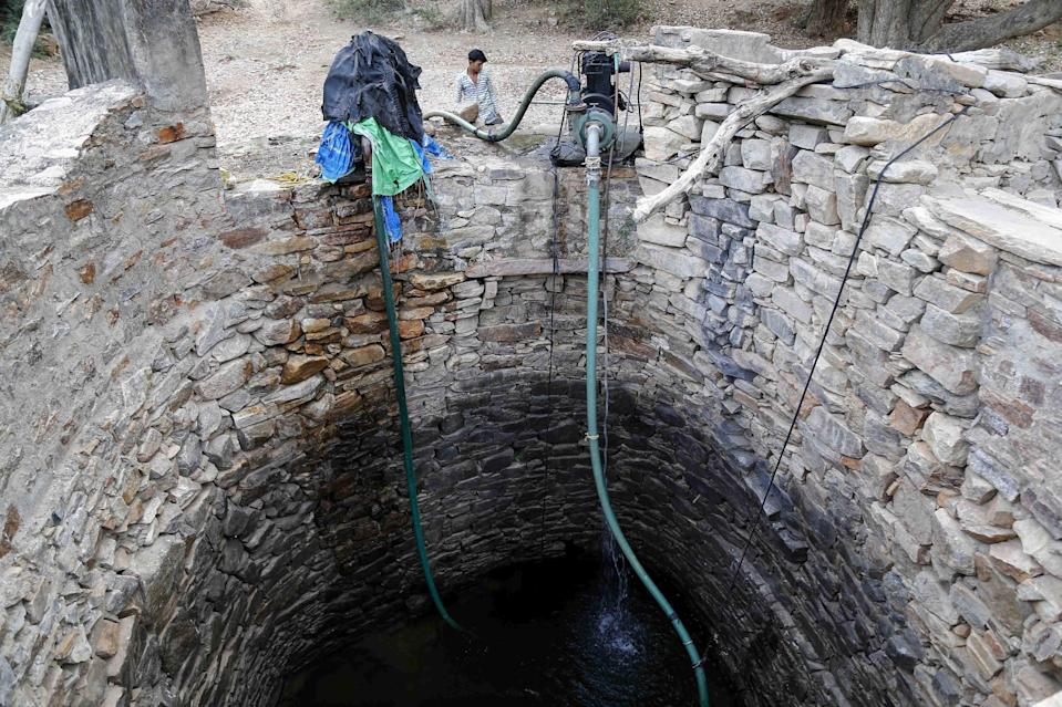 <p>The man pushed his wife and two daughters, including an infant into the well</p> (AFP via Getty Images)