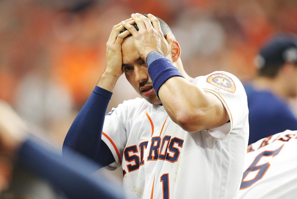 HOUSTON, TEXAS - OCTOBER 13: Carlos Correa #1 of the Houston Astros reacts after a security guard was hit by a foul ball in game two of the American League Championship Series between the Houston Astros and the New York Yankees at Minute Maid Park on October 13, 2019 in Houston, Texas. (Photo by Bob Levey/Getty Images)
