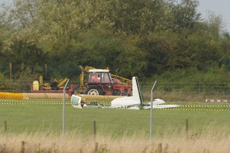 The wreckage of a light aircraft could be seen at Teesside Airport (Owen Humphreys/PA) (PA Wire)
