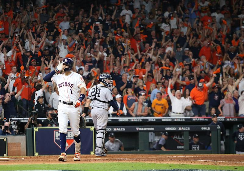 Oct 13, 2019; Houston, TX, USA; Houston Astros shortstop Carlos Correa (1) celebrates after hitting a walk off solo home run off of New York Yankees starting pitcher J.A. Happ (not pictured) during the eleventh inning in game two of the 2019 ALCS playoff baseball series at Minute Maid Park. Mandatory Credit: Thomas B. Shea-USA TODAY Sports