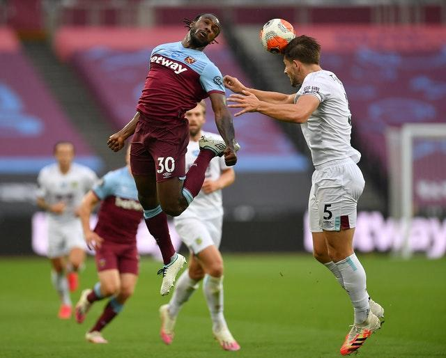 James Tarkowski, right, in action for Burnley against West Ham last season