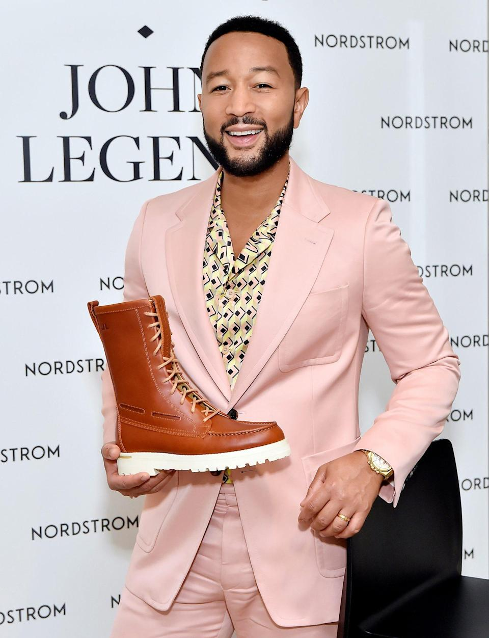 <p>John Legend gets all dressed up on Sept. 20 to celebrate the launch of his Sperry x John Legend Collection at Nordstrom at The Grove in L.A.</p>