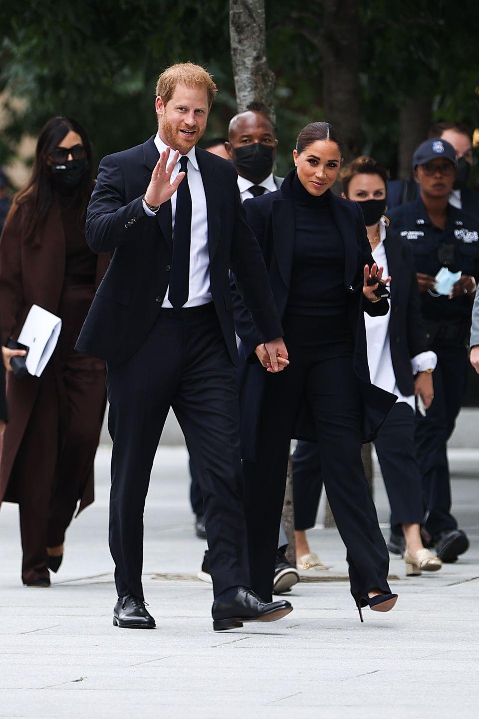 """<p>Meghan Markle has made her first public appearance following the birth of her daughter Lili in spring, and it's safe to say she looks stunning. </p><p>The Duchess of Sussex was seen walking hand-in-hand with her husband, Prince Harry outside the One World Observatory in New York City.</p><p>For the outing Markle wore what might be her chicest outfits to date - an all-black ensemble that consisted of Aquazzura stilettos, wide-leg black trousers, a black roll-neck jumper and black trench coat from Emporio Armani. The Duchess scraped her hair back into a tight bun and was later seen wearing a black face mask. </p><p><a class=""""link rapid-noclick-resp"""" href=""""https://www.elle.com/uk/fashion/what-to-wear/articles/g30975/best-trench-coats-beige-navy-black/"""" rel=""""nofollow noopener"""" target=""""_blank"""" data-ylk=""""slk:SHOP TRENCH COATS NOW"""">SHOP TRENCH COATS NOW</a></p>"""