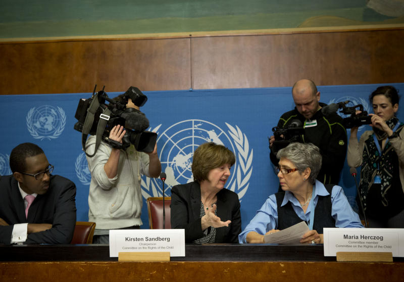 Kirsten Sandberg, center, chairperson of the U.N. human rights committee on the rights of the child, talks to committee members Maria Herczog, right, and Benyam Mezmur during a press conference at the United Nations headquarters in Geneva, Switzerland, Wednesday, Feb. 5, 2014. A U.N. human rights committee denounced the Vatican on Wednesday for adopting policies that allowed priests to rape and molest tens of thousands of children over decades, and urged it to open its files on the pedophiles and the churchmen who concealed their crimes. (AP Photo/Anja Niedringhaus)