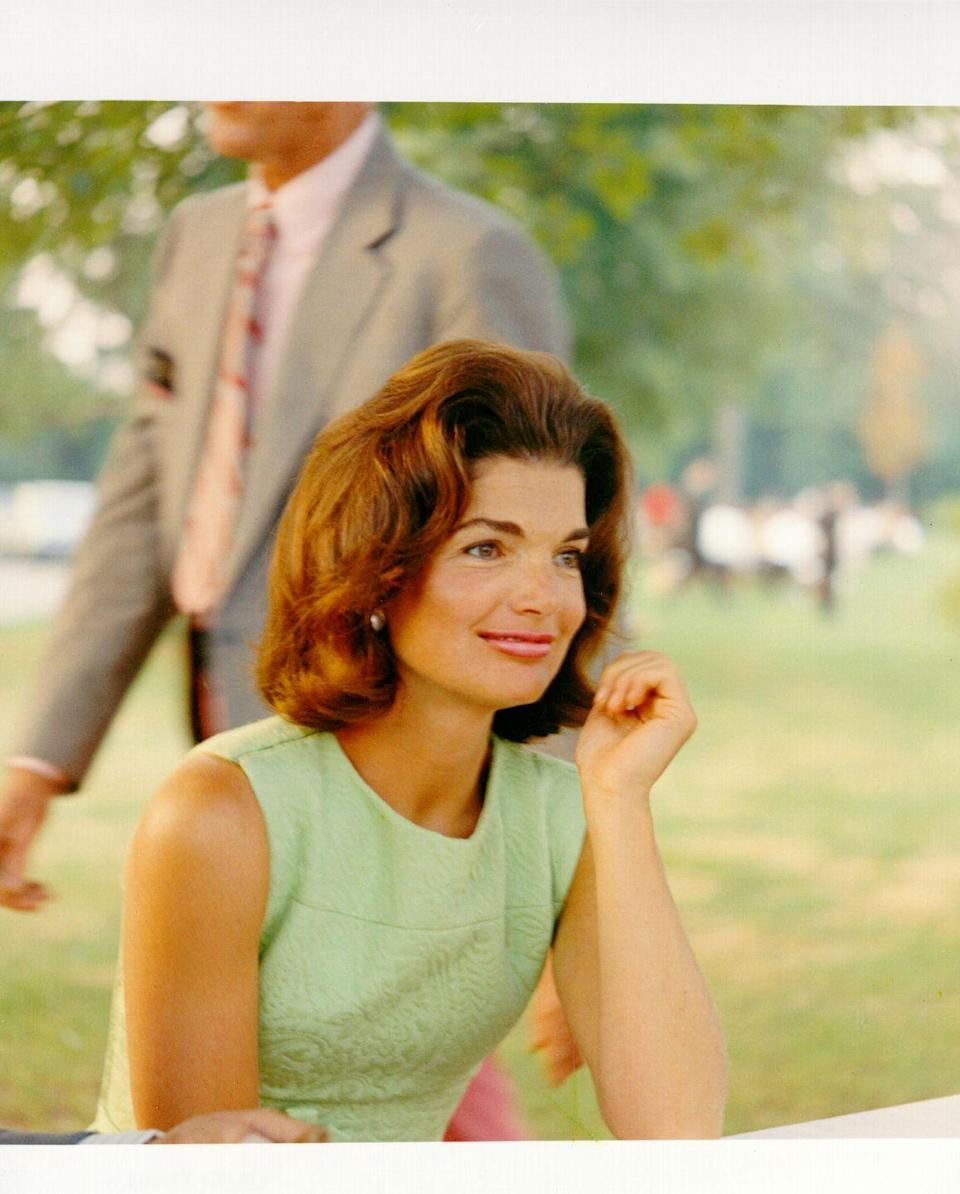 <p>Here, Jackie's timeless style is on full display: perfectly-coiffed hair, pale pink lipstick, and a sheath dress are all she needs to look completely pulled together.<br></p>