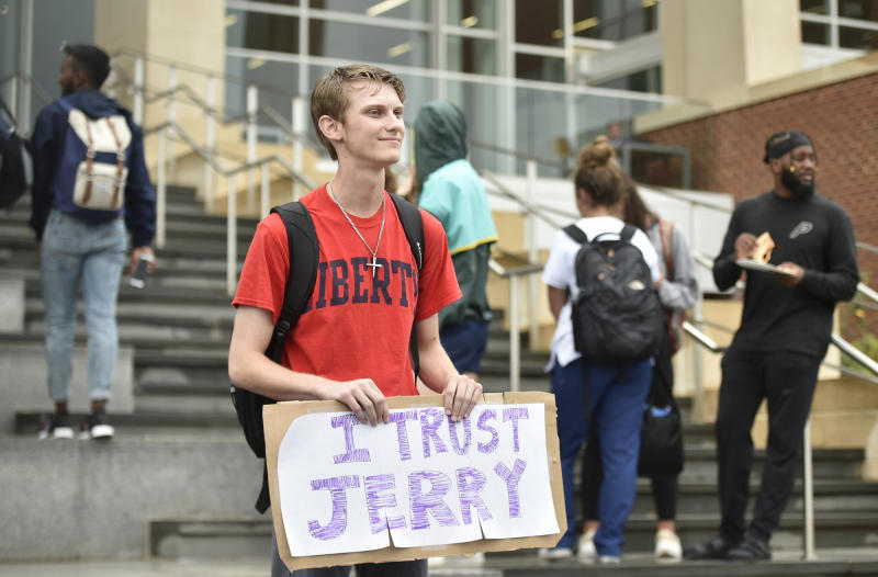 "Garreidy Hamilton, a freshman in government politics and policy holds a sign saying ""I trust Jerry"" during a student protest Liberty University in Lynchburg, Va., Friday, Sept. 13, 2019. (Taylor Irby/The News & Advance via AP)"