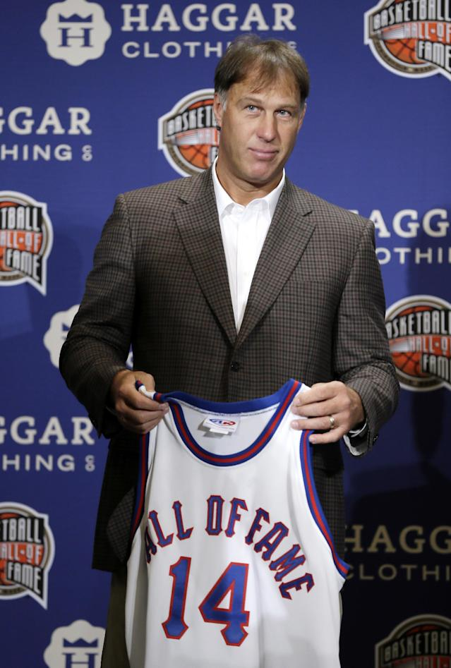 Former NBA player Sarunas Marciulionis, of Lithuania, stands on stage during the Naismith Memorial Basketball Hall of Fame class of 2014 announcement, Monday, April 7, 2014, in Dallas. (AP Photo/Charlie Neibergall)