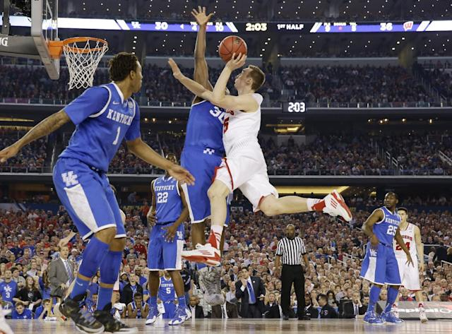 Wisconsin forward Sam Dekker (15) shoots against Kentucky forward Julius Randle (30) during the first half of the NCAA Final Four tournament college basketball semifinal game Saturday, April 5, 2014, in Arlington, Texas. (AP Photo/David J. Phillip)