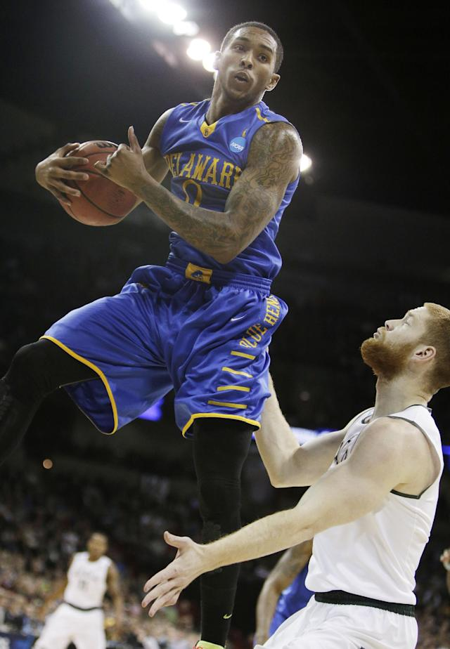 Delaware's Davon Usher, left, grabs a rebound against Michigan State's Russell Byrd in the first half during the second round of the NCAA men's college basketball tournament in Spokane, Wash., Thursday, March 20, 2014. (AP Photo/Young Kwak)