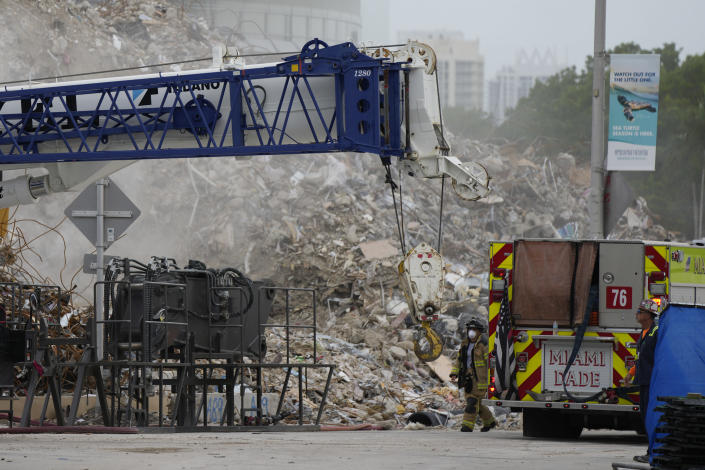 Crews work in the rubble of the demolished section of the Champlain Towers South building, as removal and recovery work continues at the site of the partially collapsed condo building, Monday, July 12, 2021, in Surfside, Fla.(AP Photo/Rebecca Blackwell)