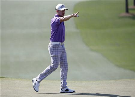 Sweden's Jonas Blixt reacts after his par putt on the seventh hole during the third round of the Masters golf tournament at the Augusta National Golf Club in Augusta, Georgia April 12, 2014. REUTERS/Jim Young