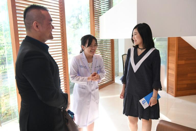 Zhang Yinzhe (L) and Xu Mengsha (R) decided they wanted to use in-vitro fertilisation (IVF) to freeze an embryo in the hope of one day having a second child