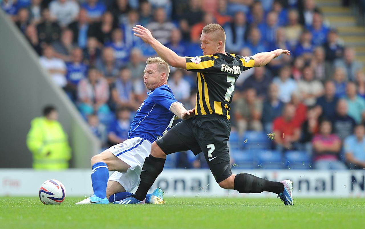 Southend United's Freddy Eastwood and Chesterfield's Ritchie Humphreys battle for the ball during the Sky Bet Football League Two match at the Proact Stadium, Chesterfield.