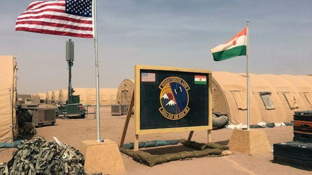 PHOTO: In this photo taken Monday, April 16, 2018, a U.S. and Niger flag are raised side by side at the base camp for air forces and other personnel supporting the construction of Niger Air Base 201 in Agadez, Niger. (Carley Petesch/AP, File)