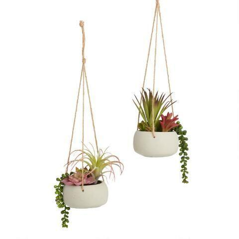 """<p>worldmarket.com</p><p><strong>$29.98</strong></p><p><a href=""""https://go.redirectingat.com?id=74968X1596630&url=https%3A%2F%2Fwww.worldmarket.com%2Fproduct%2Ffaux%2Bsucculents%2Bin%2Bcement%2Bpots%2Bhanging%2Bdecor%2Bset%2Bof%2B2.do&sref=https%3A%2F%2Fwww.womenshealthmag.com%2Flife%2Fg34483134%2Fbest-fake-plants%2F"""" rel=""""nofollow noopener"""" target=""""_blank"""" data-ylk=""""slk:Shop Now"""" class=""""link rapid-noclick-resp"""">Shop Now</a></p><p>Hang these cute faux plants in cement pots, and never worry about whether they're thriving.</p>"""