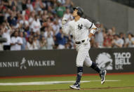 New York Yankees' Aaron Judge reacts as he rounds the bases after a two-run home run against the Boston Red Sox during the fourth inning of a baseball game, Saturday, June 29, 2019, in London. Major League Baseball made its European debut game today at London Stadium. (AP Photo/Tim Ireland)