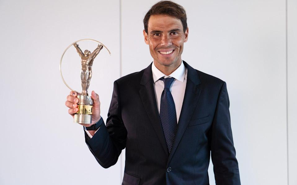 Nadal with his Laureus world sportsman of the year award for 2021