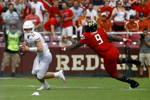 "Texas quarterback <a class=""link rapid-noclick-resp"" href=""/ncaaf/players/275098/"" data-ylk=""slk:Sam Ehlinger"">Sam Ehlinger</a>, left, looks for a receiver as he is pressured by Maryland defensive lineman Byron Cowart in the first half of an NCAA college football game, Saturday, Sept. 1, 2018, in Landover, Md. (AP Photo/Patrick Semansky)"