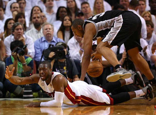 MIAMI, FL - JUNE 18: Dwyane Wade #3 of the Miami Heat reacts after going after a loose ball against Boris Diaw #33 of the San Antonio Spurs in the second half during Game Six of the 2013 NBA Finals at AmericanAirlines Arena on June 18, 2013 in Miami, Florida. NOTE TO USER: User expressly acknowledges and agrees that, by downloading and or using this photograph, User is consenting to the terms and conditions of the Getty Images License Agreement. (Photo by Mike Ehrmann/Getty Images)